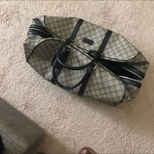Authentic Gucci 45  duffle luggage on wheels